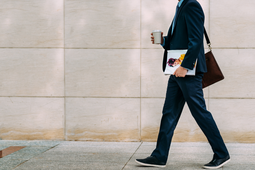 businessman with coffee and magazine going to work
