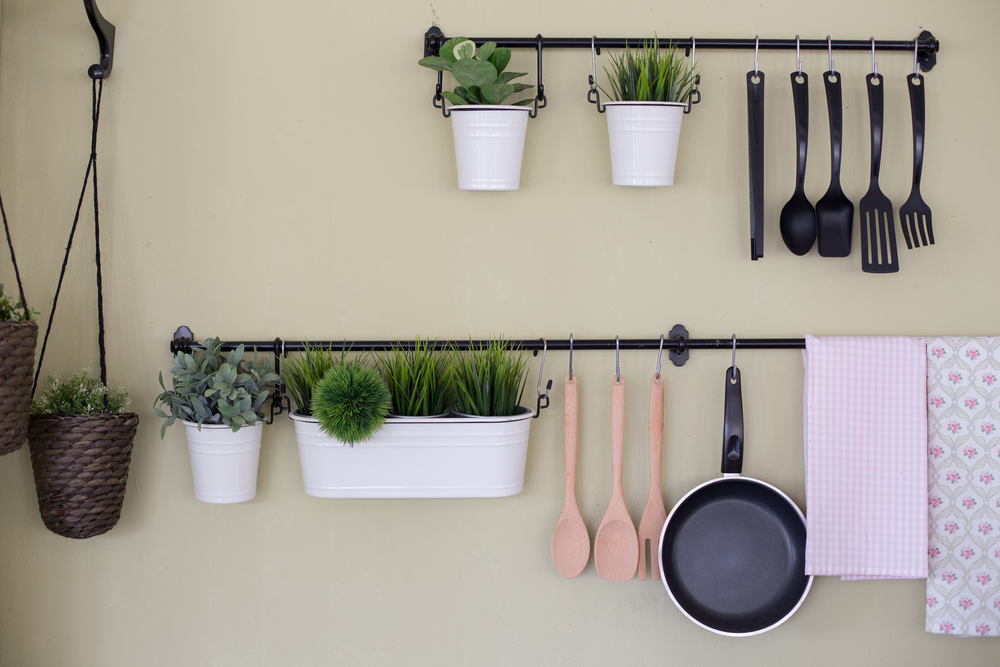 Kitchenware tree hanging on wall