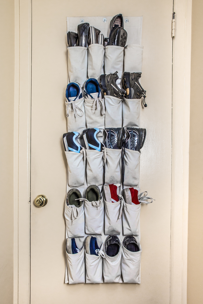 Various athletic shoes on pockets door