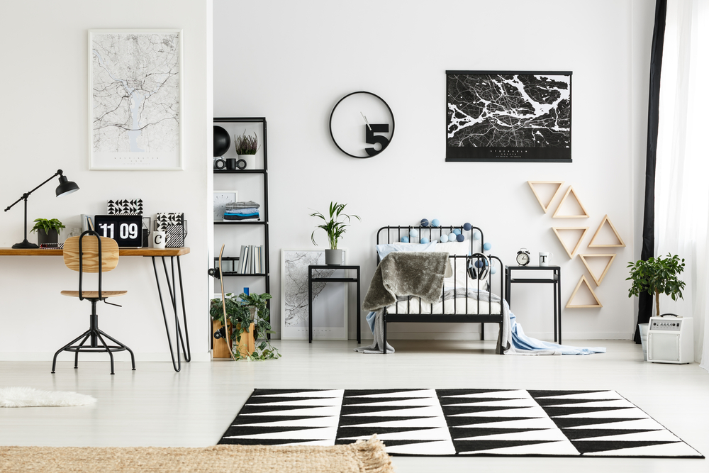 Black and white bedroom with workspace