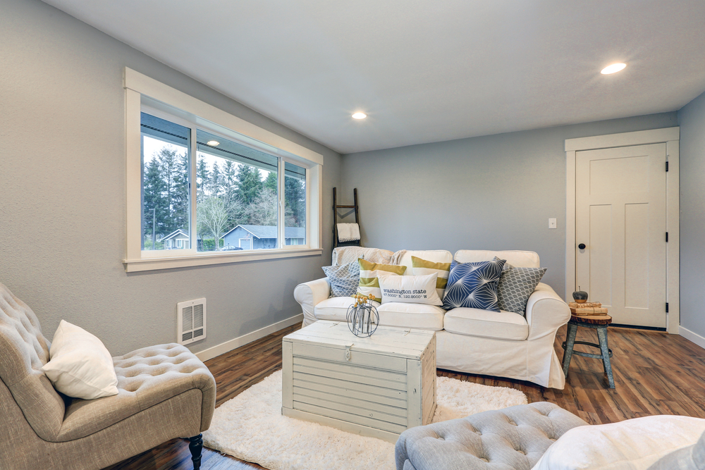 Cozy living room space with soft blue grey walls