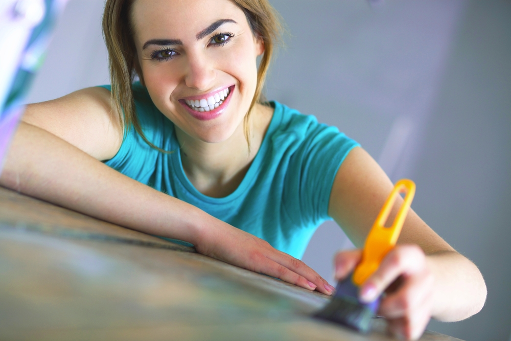 young woman with painting tools