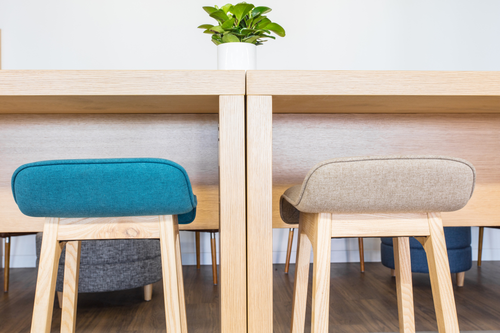 Two wooden high stools with wooden table