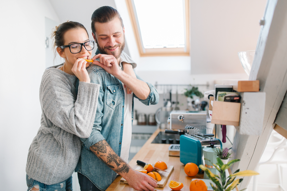 Young couple making breakfast