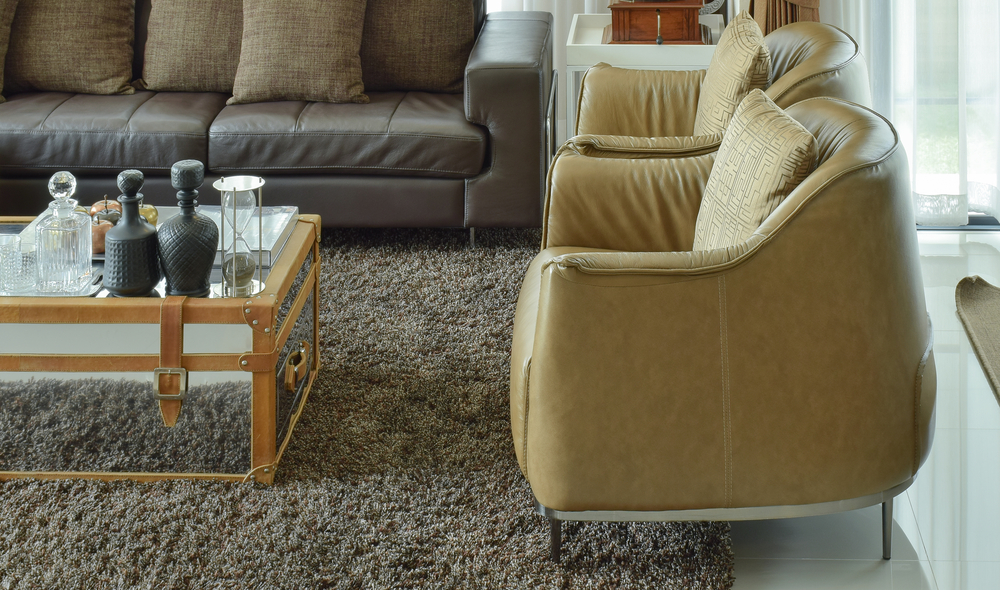 Light brown leather armchairs