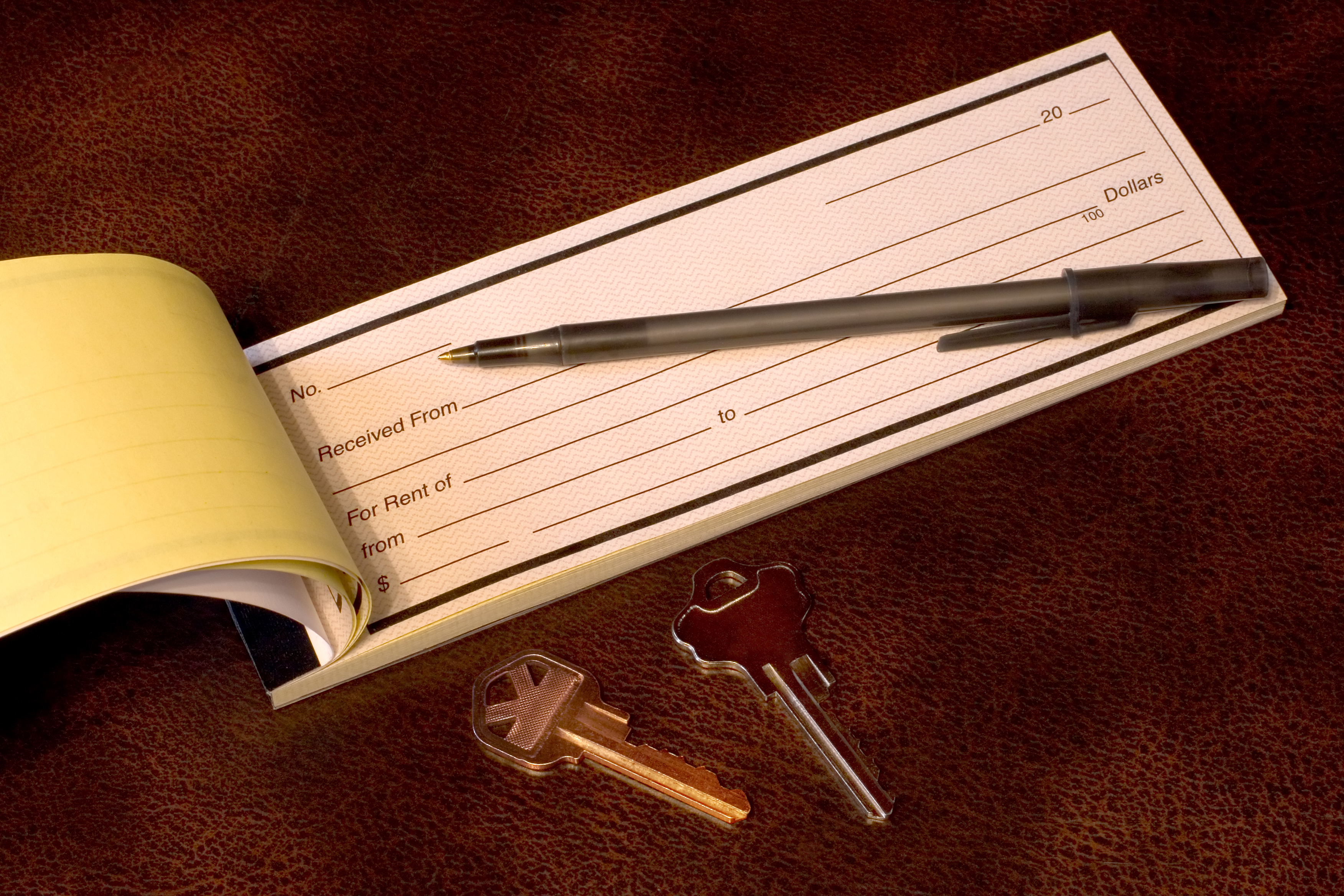 A rent receipt book with keys